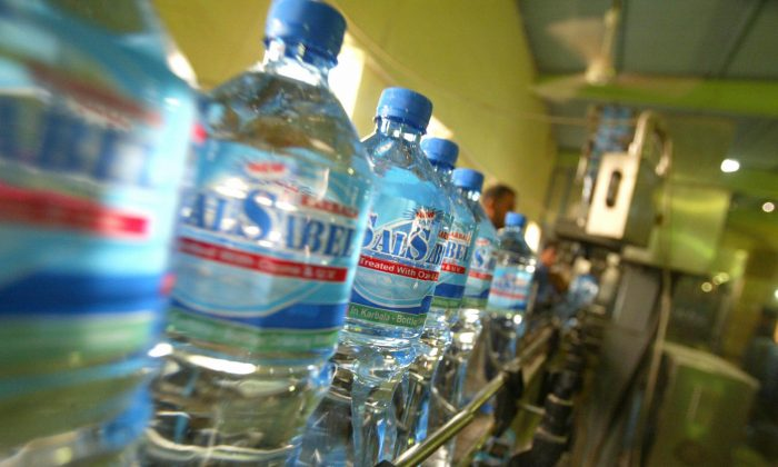Sealed plastic water bottles roll on a conveyor belt at the Sal Sabel water company on Sept. 14 2008, near the southern Iraqi city of Karbala. (Mohammed Sawaf/AFP/Getty Images)