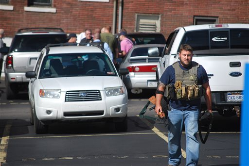 U.S. Deputy Marshall Chad Simpson walks near the Federal Building in Wheeling, W.Va, on Wednesday, Oct. 9, 2013. West Virginia State Police say a man who fired shots at a federal courthouse in Wheeling has died from police fire. State police spokesman Sgt. Michael Baylous confirmed that the man died Wednesday. The U.S. Marshals Services says officers fired at the man after he shot up to two dozen rounds at the courthouse. (AP Photo/Wheeling News Register & The Intelligencer, Scott McCloskey)