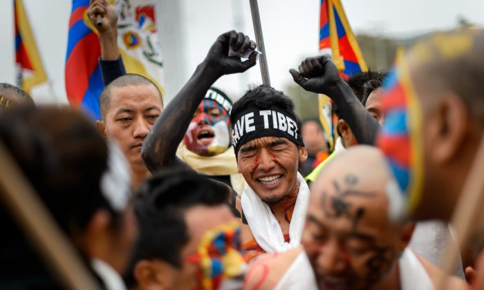 Tibetan activists hold a demonstration on October 22, 2013 outside the United Nations offices in Geneva. The protest took place as China was set to undergo a widely anticipated review of its rights record before the United Nations Human Rights Council—something required of each of the UN's 193 member states every four years. (Fabrice Coffrini/AFP/Getty Images)