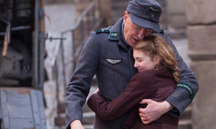 "Liesel (Sophie Nélisse) and her foster father Hans (Geoffrey Rush) share a quiet moment in the film ""The Book Thief.""(Jules Heath/Twentieth Century Fox Film Corporation)"