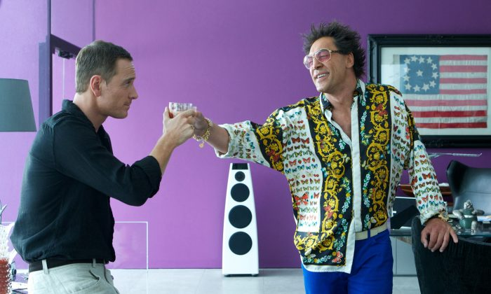 The Counselor (Michael Fassbender, left) and Reiner (Javier Bardem) toast their deal—unaware that they'll soon pay a heavy price for it. (Kerry Brown - TM and © 2013 Twentieth Century Fox Film Corporation)