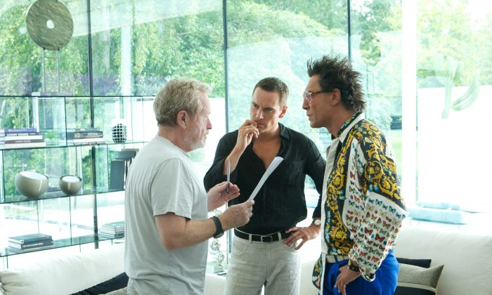 Director Ridley Scott (left) discusses a scene with Michael Fassbender and Javier Bardem on the set of The Counselor. (Kerry Brown/Twentieth Century Fox Film Corporation)
