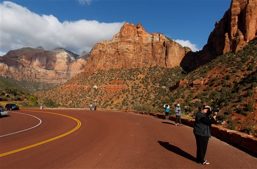 Visitors to Zion National Park take in the sights after the park opened on a limited basis Friday, Oct. 11, 2013 near Springdale, Utah. (AP Photo/The Salt Lake Tribune, Trent Nelson)