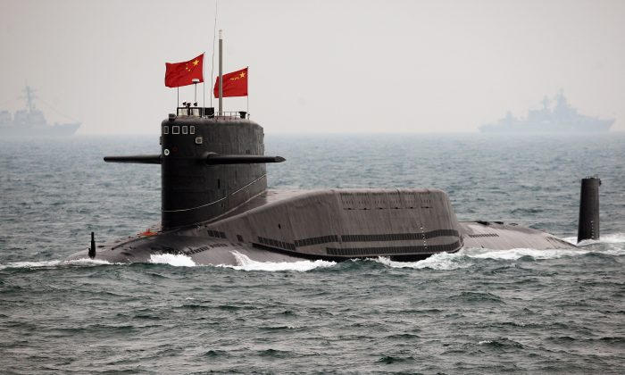 A Chinese Navy submarine on April 23, 2009, off Qingdao in China's Shandong Province. Recently, the Chinese state-run media have boasted of the ability of China's submarine fleet to target the United States with ballistic missiles. (Guang Niu/AFP/Getty Images)