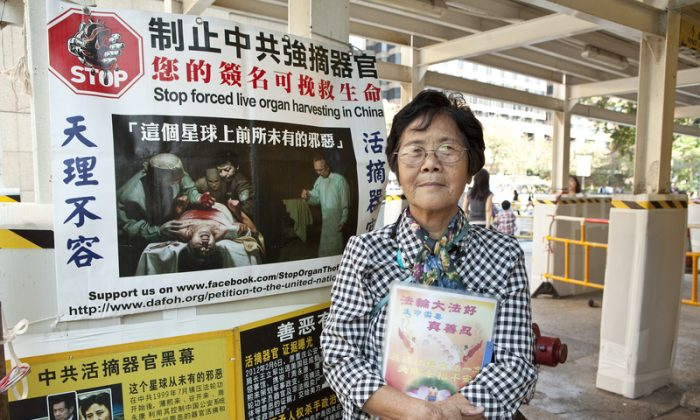 Ms Liao has volunteered, helping people renounce the CCP, outside of Tsim Sha Tsui East in Hong Kong for 9 years. (Epoch Times)