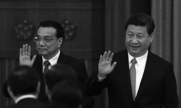 Chinese Communist Party (CCP) head Xi Jinping (Right) and Premier Li Keqiang (Left) wave to guests as they arrive for a dinner marking the 64th anniversary of the founding of the People's Republic of China at the Great Hall of the People on Sept. 30, 2013 in Beijing, China. The two were responsible for issuing a collection of reforms at the Third Plenum of the 18th Central Committee, which are meant to rescue the CCP from crisis. (Feng Li/Getty Images)