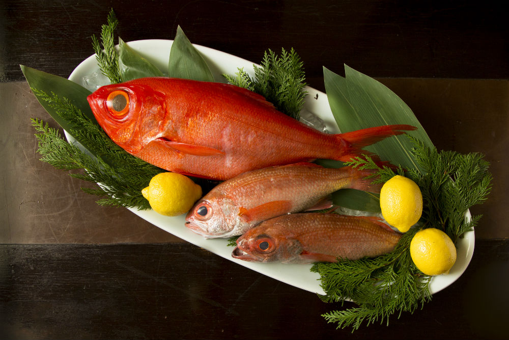 A golden eye snapper (top) and two black throat sea perch fish at Sushi Zen restaurant, Feb. 25, 2014. (Samira Bouaou/Epoch Times)