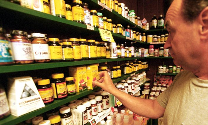 A customer looks at vitamins at Green Street Natural Foods in Melrose, Mass., on July 10, 2001. (Darren McCollester/Getty Images)