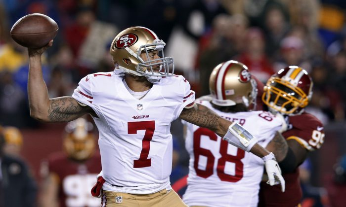 San Francisco 49ers quarterback Colin Kaepernick passes during the first half of an NFL football game against the Washington Redskins in Landover, Md., Monday, Nov. 25, 2013. (AP Photo/Alex Brandon)