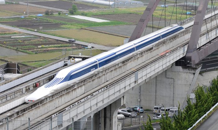 The Maglev (magnetic levitation) train speeds through during a test run on the experimental track in Tsuru, west of Tokyo, on May 11, 2010. The US transport chief was on the test ride on Japan's super-fast magnetic train, a contender for President Barack Obama's multi-billion-dollar national railway project.(Toru Yamanaka/AFP/Getty Images)