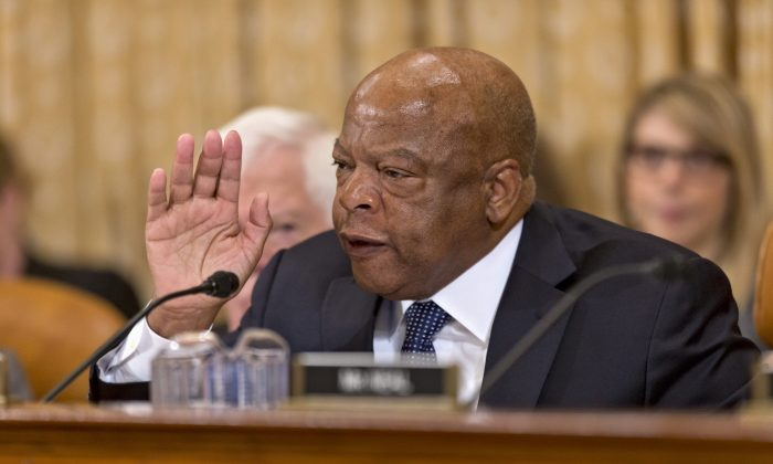 House Ways and Means Committee member Rep. John Lewis (D-Ga.) comes to the defense of President Barack Obama's health care law during the committee's hearing on Capitol Hill in Washington, Tuesday, Oct. 29. (AP Photo/J. Scott Applewhite)