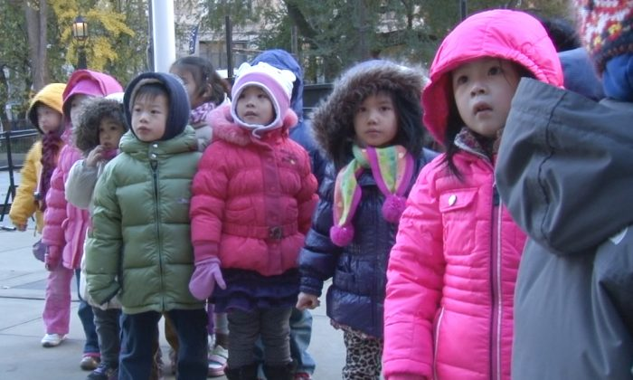 Pre-Kindergarten children line up before a press conference at the steps of New York City Hall on Nov. 13, 2013. Advocates want to see Mayor-elect Bill de Blasio lock pre-K funding in next year's city budget. (Screenshot/NTD Television)
