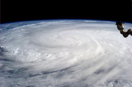 This image provided by NASA shows Typhoon Haiyan taken by Astronaut Karen L. Nyberg aboard the International Space Station Saturday Nov. 9, 2013. (AP Photo/NASA, Karen L. Nyberg)