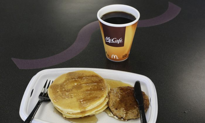 A McDonald's breakfast is arranged for an illustration at a McDonald's restaurant in New York on Feb. 14, 2013. The pancakes and sausage are served on a foam tray and coffee is served in a foam cup. (Mark Lennihan/AP)