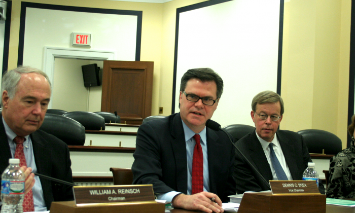 (L to R) William Reinsch, chairman of the U.S.-China Economic and Security Review Commission; Dennis Shea, vice chairman; Commissioner James Talent, and Commissioner Katherine Tobin at a news conference, Nov. 20, when the commission released to the public its 2013 report to Congress. (Gary Feuerberg/Epoch Times)