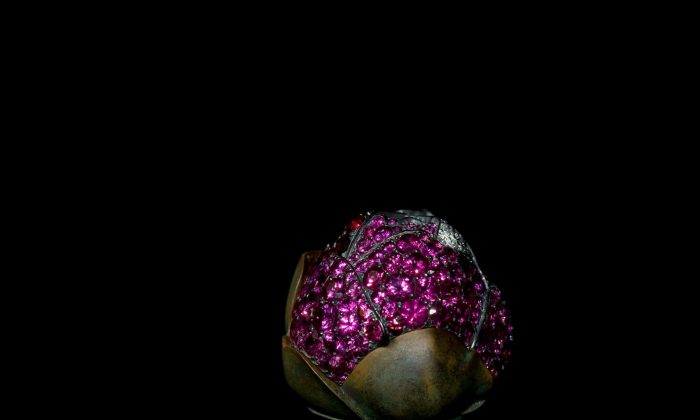 JAR Camellia Brooch (2010). Rubies, pink sapphires, diamonds, silver, and gold. Private collection Photograph by Jozsef Tari. (Courtesy of JAR, Paris)