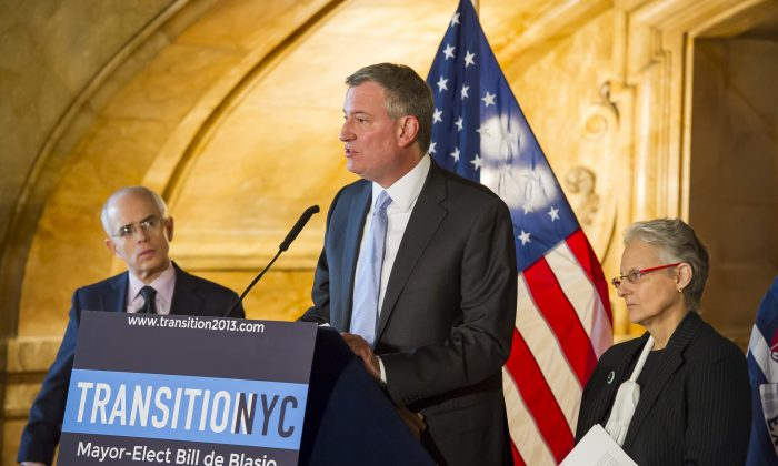 Mayor-elect Bill de Blasio (C) speaks at the appointment of Lilliam Barrios-Paoli (R), while appointed First Deputy Mayor Tony Shorris (L) looks on, during a press conference in Manhattan, New York, on Dec. 12, 2013. (Rob Bennett)