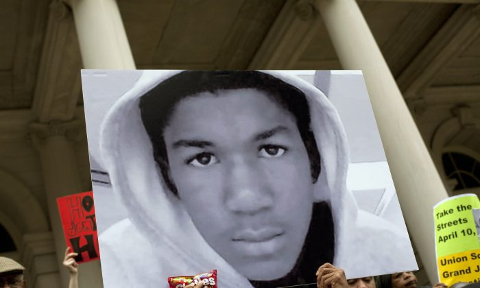 17-year-old Trayvon Martin, who was killed while wearing a hoodie, is seen during a protest in this March 2012 file photo. George Zimmerman was ultimately acquitted of wrongdoing in the death. (Allison Joyce/Getty Images)