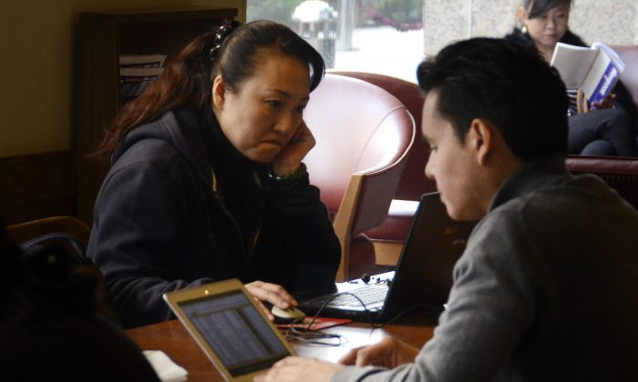 People use their computers at a cafe in Beijing, Nov. 2, 2012. Recently, a Chinese blogger has been arrested for a post that warned of forced organ harvesting taking place in Shanxi Province. (WANG ZHAO/AFP/Getty Images)