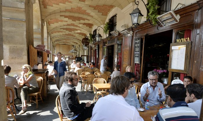 A photo taken on July 12, 2013 shows people on the terrace of a cafe on the Place des Vosges square in the Marais district in the 3rd and 4th arrondissements of Paris. (MIGUEL MEDINA/AFP/Getty Images)