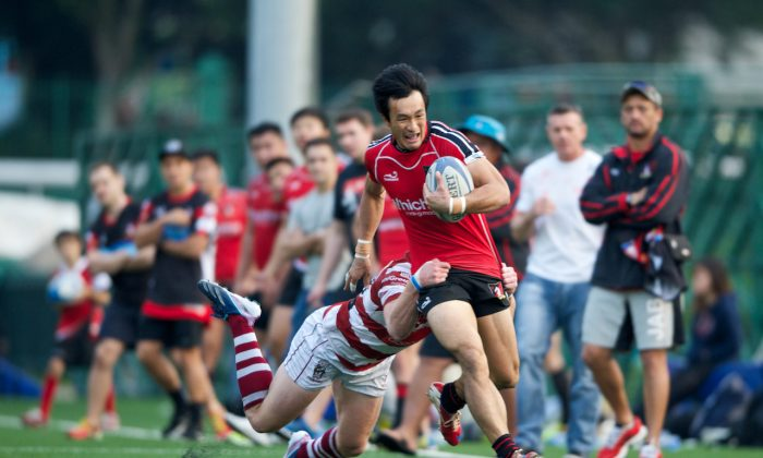WhichWay Valley and Hong Kong winger Salom Yiu on his way to scoring in their match against Abacus Kowloon in the HKRFU Paul Y Premiership at Happy Valley on Saturday Dec 7, 2013. Valley won the match 26-13 to move them onto 31 points in the league and retain the Broony Quaich trophy. (HKRFU)