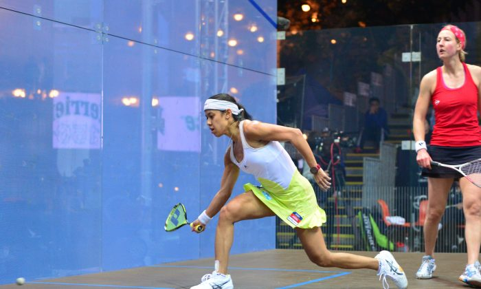 Nicol David of Malaysia plays a forehand shot at the front of the court during her Semi-final match in the Hong Kong Open 2013, which she won 3-1 against Alison Waters of England at the harbour side venue on Saturday Dec 7, 2013. David went on to win the tournament for the eighth time beating Egyptian Raneem El Weleily in the Final. (Eddie So)