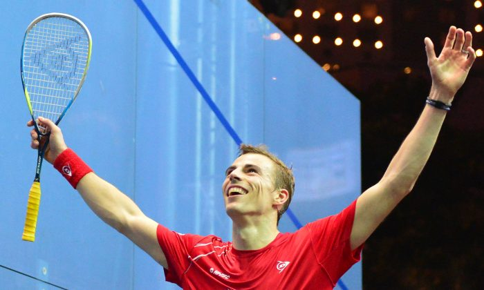 Nick Matthew of England celebrates after winning the Final of the Hong Kong Open 2103 against Spaniard Borja Golan on Sunday Dec 8, 2013. Nick Matthew won the match 11-13, 11-8, 5-11, 11-5 to take the title for the first time. (Eddie So)