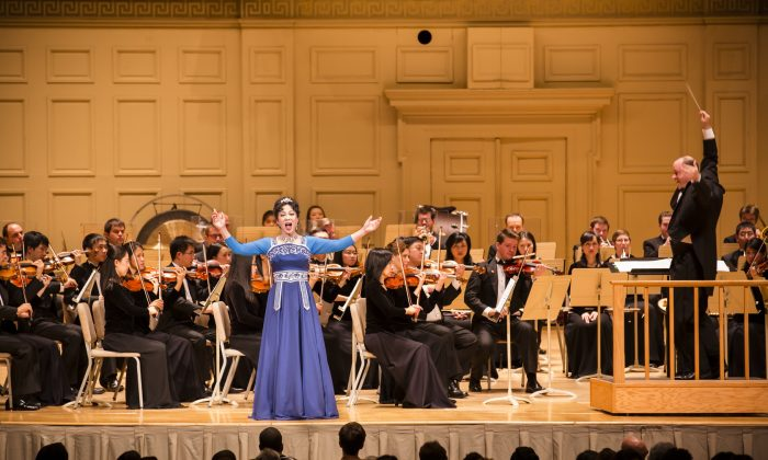 "Shen Yun Symphony Orchestra soprano Min Jiang sings ""Heavenly Secret"" at the Boston Symphony Hall on Oct. 9, 2013. The orchestra is the only one in the world that combines classical Western and Chinese instruments as its permanent members. (Edward Dai/Epoch Times)"