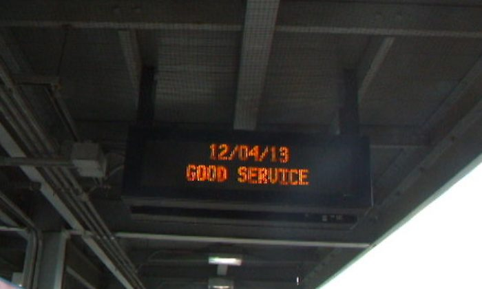 """Sign at Spuyten Duyvil Station reads """"Good Service,"""" in the Bronx, New York, Dec. 4, 2013. (Holly Kellum)"""