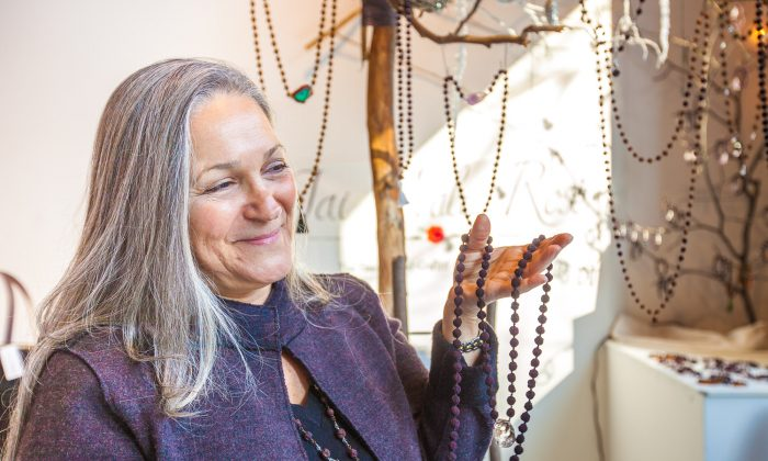 Celeste Onorati presenting a rose petal mala at Hester Street Fair's pop-up shop on the corner of Sixth Avenue and 29th Street in Manhattan, Dec. 4. (Petr Svab/Epoch Times)