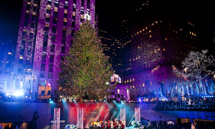 The 76-foot-tall tree is lit with 45,000 lights during the 81st Annual Rockefeller Center Christmas Tree Lighting Ceremony in New York on Dec. 4, 2013. This year, the Christmas tree will be an 85-foot, 13-ton Norway spruce. (Samira Bouaou/Epoch Times)