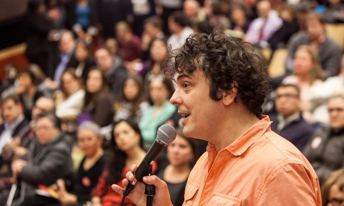 Marco Batistella, a parent who opted his child out from fourth-grade math and English tests, speaks at a community forum on Common Core at the Spruce Street School, Manhattan, New York, Dec. 11, 2013. (Petr Svab/Epoch Times)