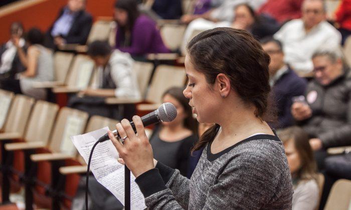 Natasha Muñoz speaks at a community forum at the Spruce Street School, Manhattan, New York, Dec. 11, 2013. (Petr Svab/Epoch Times)