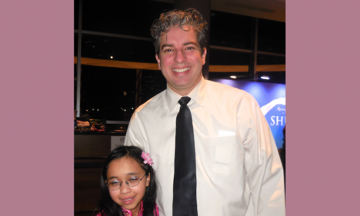 Shawn Dick brought his young daughter to experience Shen Yun Performing Arts at the Long Center for the Performing Arts, on Dec. 28. (Stacy Chen/Epoch Times)