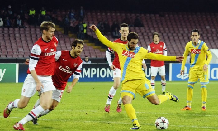 Napoli's Gonzalo Higuain scores, during a Champions League, group F, soccer match between Napoli and Arsenal, at the Naples San Paolo stadium, Italy, Wednesday, Dec. 11, 2013. (AP Photo/Salvatore Laporta)