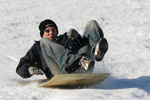 Barrie Clark of Christchurch makes the most of a homemade sled and slippery slope June 17, 2006 outside Fairlie, New Zealand. (Simon Fergusson/Getty Images)