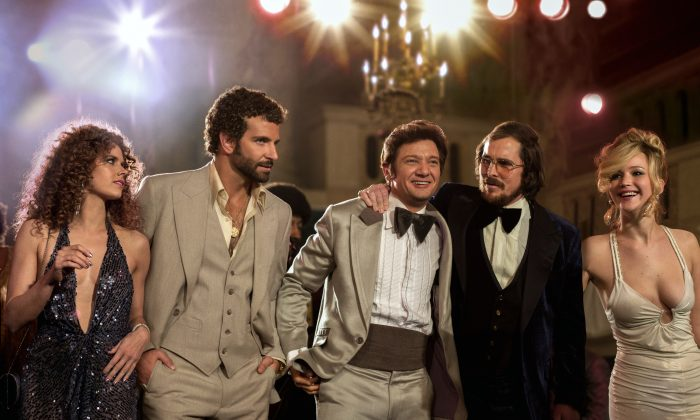 """(L-R) Amy Adams, Bradley Cooper, Jeremy Renner, Christian Bale and Jennifer Lawrence in a scene from """"American Hustle."""" (AP Photo/Sony - Columbia Pictures, Francois Duhamel)"""