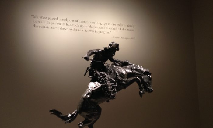 """A view of """"The Broncho Buster,"""" 1895 (cast 1906), by Frederic Remington (1861–1909) at the Metropolitan Museum's exhibit, """"The American West in Bronze."""" (Christine Lin/ Epoch Times)"""