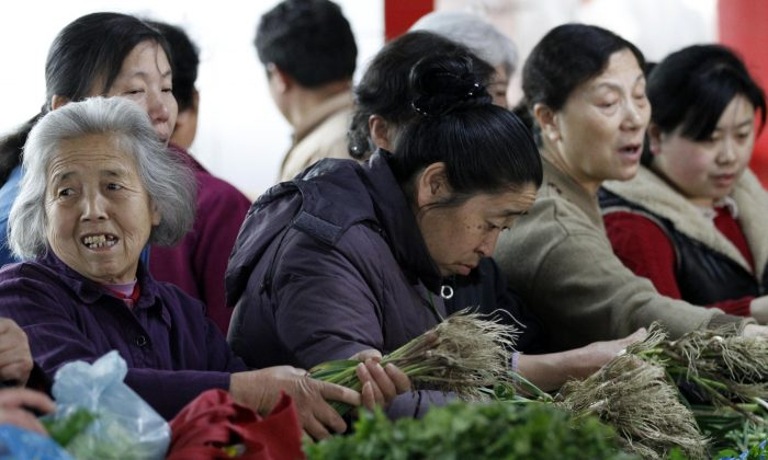 People purchase vegetables at a market on April 9, 2013 in Nanjing, China. China's consumer price index (CPI), the main gauge of inflation, rose 3 percent year-on-year in November. (ChinaFotoPress/ChinaFotoPress via Getty Images)