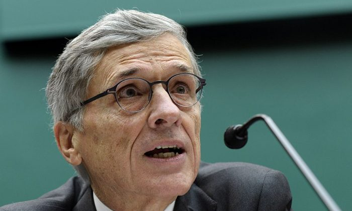 Federal Communications Commission (FCC) Chairman Tom Wheeler testifies on Capitol Hill, before the House Energy and Commerce Committee hearing concerning cellphones on planes, Dec. 12. (AP Photo/Susan Walsh)