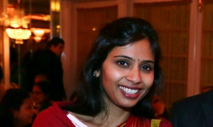 """Devyani Khobragade, India's deputy consul general, during the India Studies Stony Brook University fund raiser event at Long Island, New York, Dec. 8, 2013. The Indian diplomat said U.S. authorities subjected her to a strip search, cavity search and DNA swabbing following her arrest on visa charges in New York City, despite her """"incessant assertions of immunity."""" The case has sparked widespread outrage in India and infuriated the government, which revoked privileges for U.S. diplomats to protest her treatment. (AP Photo/Mohammed Jaffer)"""