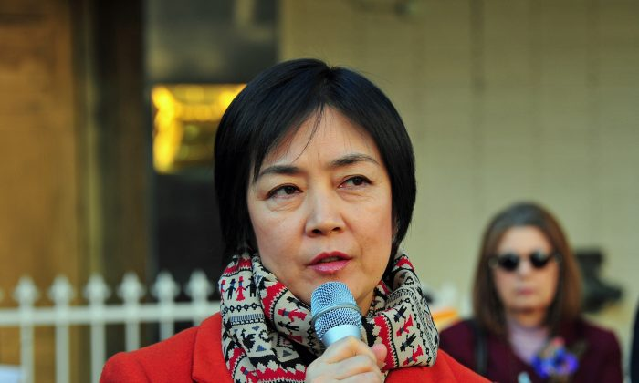 """Jennifer Zeng, a best-selling author who was featured in the award-winning film """"Free China,"""" spoke at the rally on Dec. 10 in Los Angeles, Calif. Zeng was victim of the persecution of Falun Gong in China. (Robin Kemker/The Epoch Times)"""