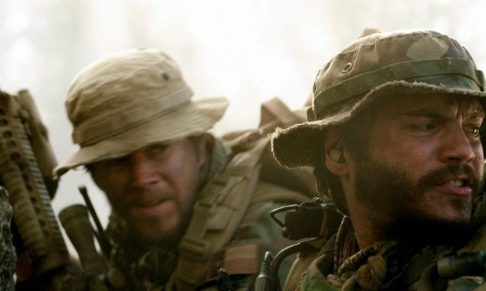 """(L–R) Marcus Luttrell (Mark Wahlberg) and Danny Dietz (Emile Hirsch) in """"Lone Survivor,"""" the true story of four Navy SEALs on a covert mission to neutralize a high-level Taliban operative in the mountains of Afghanistan. (Courtesy of Universal Pictures)"""