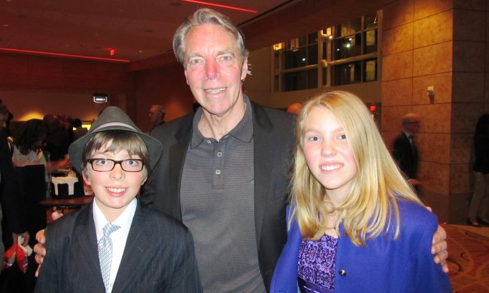 Michael Mjehovich, with his children Spencer and Jenna, enjoys an evening at Shen Yun Performing Arts at Atlanta's Cobb Energy Performing Arts Centre. (Roland Ree/Epoch Times)