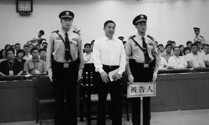 Disgraced former Politburo member Bo Xilai (L) during his sentencing at the Jinan Intermediate People's Court, Jinan, eastern China's Shandong Province, Sept. 22. (Feng Li/Getty Images)