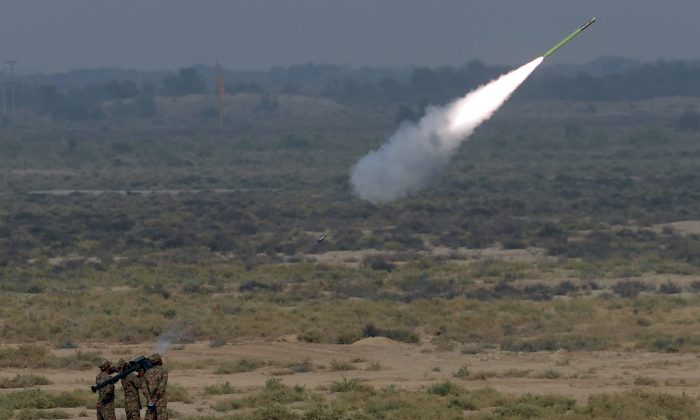 A file photo of Pakistani soldiers using a rocket launcher on Nov. 4, 2013. The U.S. Army has tested a laser weapon that can be used to intercept rockets. (Aamir Qureshi/AFP/Getty Images)