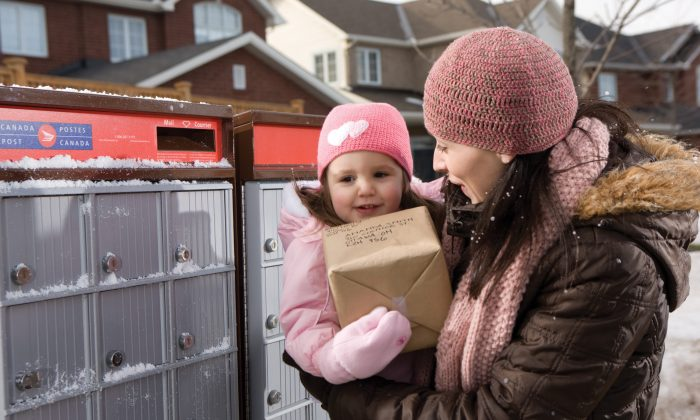 Parliament's transport committee held an emergency meeting to look into Canada Post's decision to stop home delivery for five million Canadian households. To save costs, home delivery will be replaced by community mail boxes. (Canada Post)