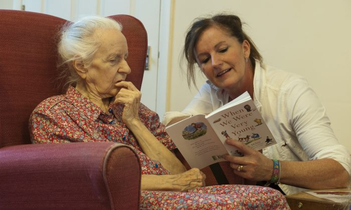 A volunteer reads poems to a dementia sufferer at a care home in Stratford, UK.  (WILL OLIVER/AFP/Getty Images)