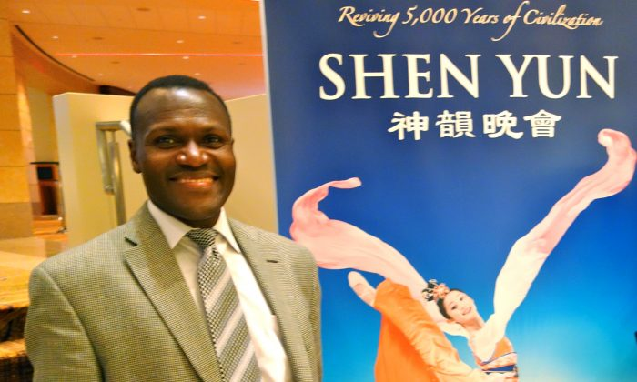 Mr. Otswila Nawade never misses Shen Yun Performing Arts when it visits Atlanta. He is in the lobby of the Cobb Energy Centre in Atlanta on Dec. 29. (Mary Silver/Epoch Times)