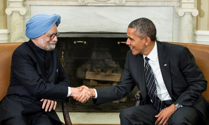 Indian Prime Minister Manmohan Singh (L) shakes hands with US President Barack Obama in the Oval Office of the White House September 27, 2013 in Washington, DC. Recently an industrial body in India has pointed that the Indian and the U.S. relations are too strongly tied to their economies, which leaves a frail chance of any possible distrust between the two nations. (Brendan Smialowski/AFP/Getty Images)